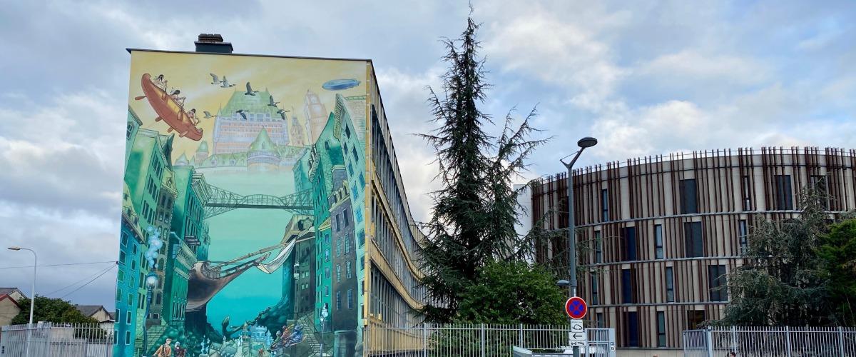Quartier des États-Unis et murs peints, visite audio-guidée sur smartphone à Pied